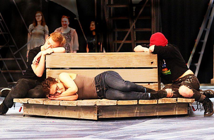 Dan Davis (left), Isabel Zyla (center) and Juliana Marasco (right) rehearse a peaceful scene from