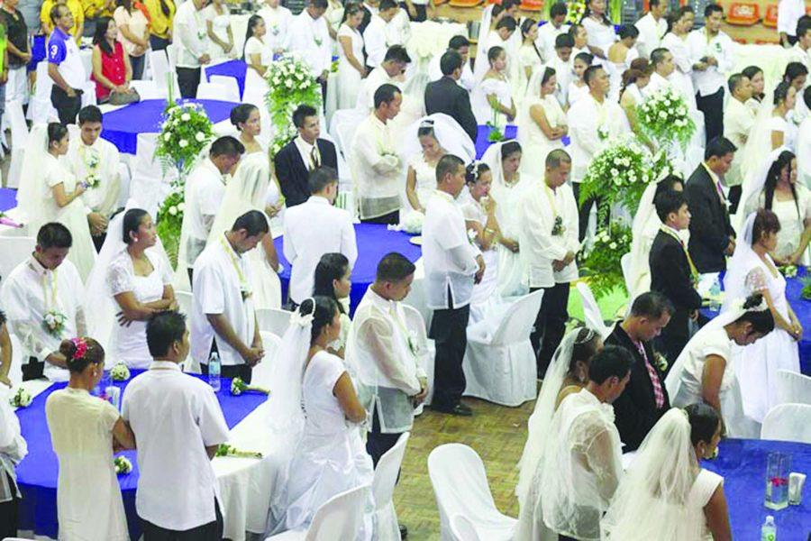 More than 80 couples join the mass wedding at Mandaue City, Cebu. A lot of couples avail of mass weddings because it is cheaper as it is usually sponsored by the city government like this one here. (Cheryl Baldicantos)