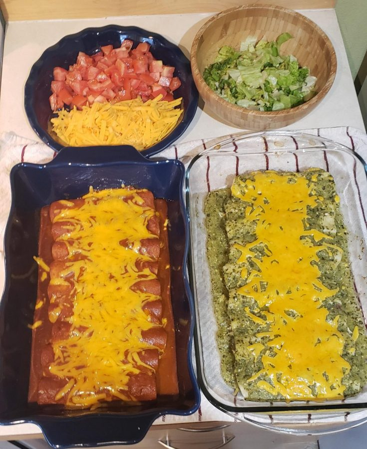 red and green enchiladas along with toppings on the side.
