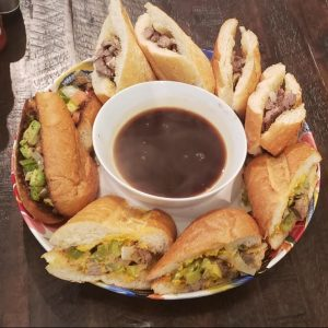 Steak sandwich variety plate that includes tortas, French dips and philly cheese steak sandwiches.