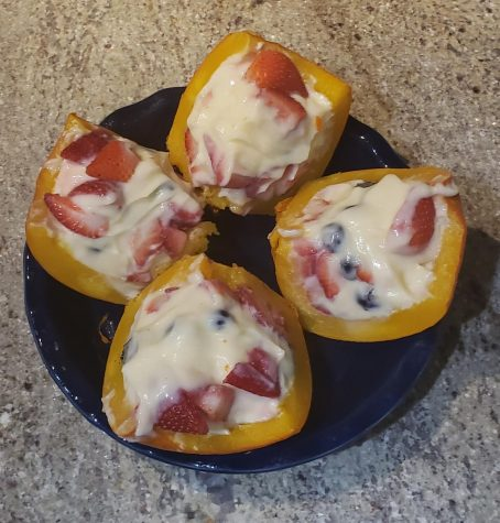 4 slices of mini pumpkin, stuffed with cheese cake, strawberries & blueberries