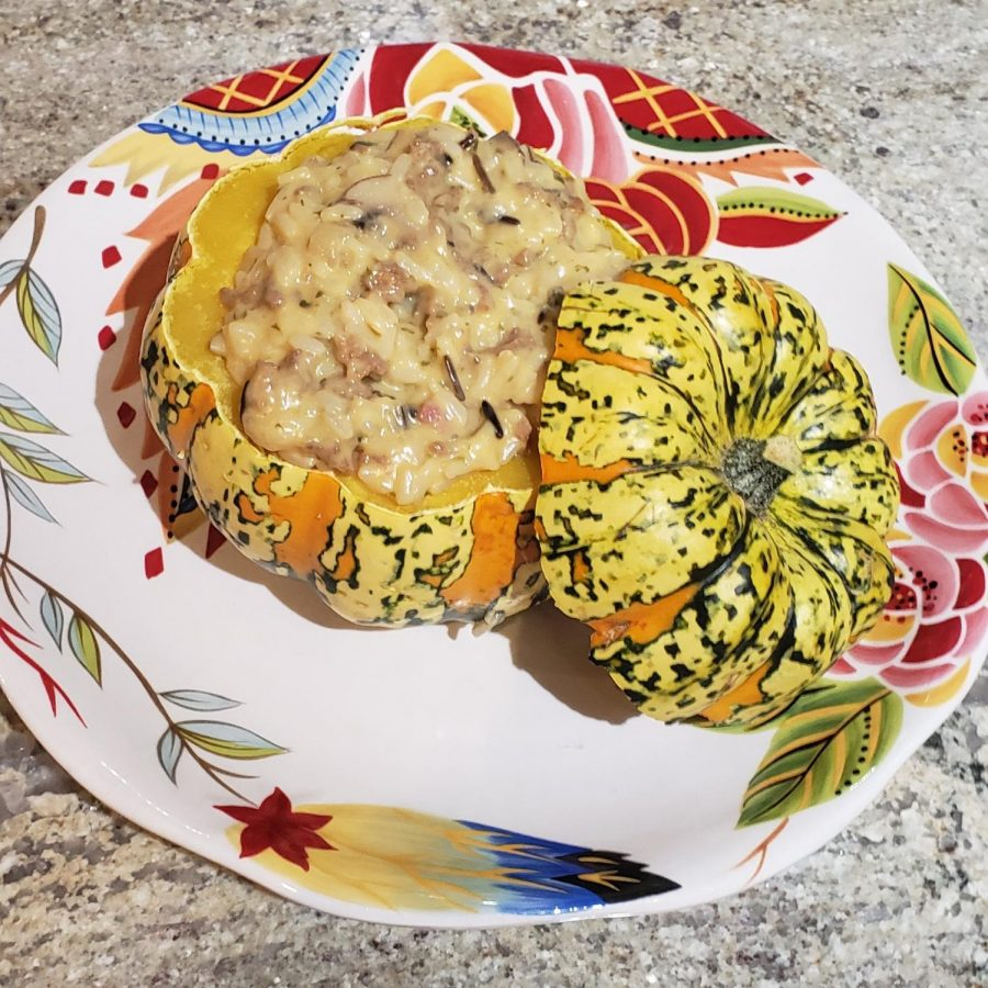 A mini stuffed pumpkin with wild rice, sausage and cheese.