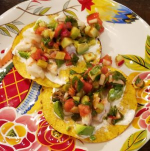 2 shrimp ceviche tostadas with avocado, ready to eat