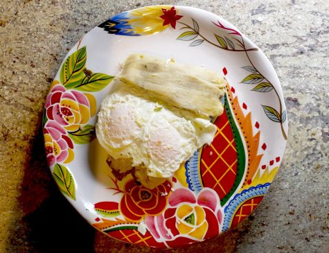 Sweet Green Corn Tamales topped with eggs and served for breakfast.