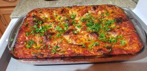 Lasagna topped with parsley.