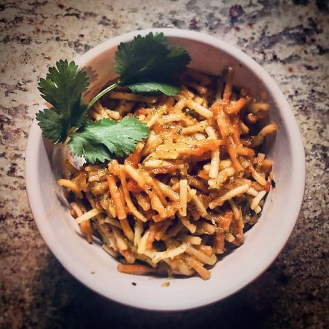 Fideo garnished with cilantro.