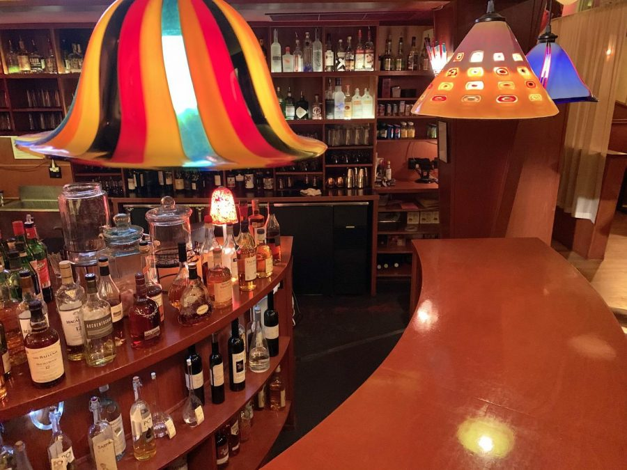 The colorful lamps at Saltoro give its bar a unique ambiance.